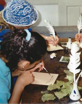 Students learn to use quills to write in journals